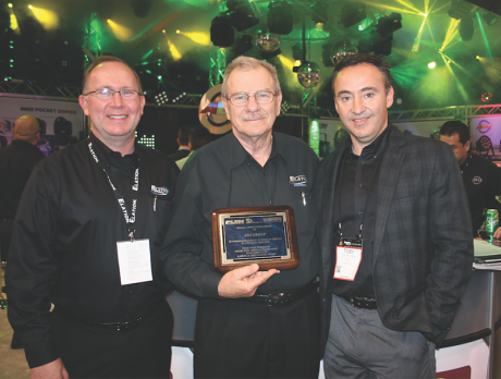 Timeless Communications, parent company to PLSN magazine, presented a plaque commemorating ADJ's 30 years at Winter NAMM 2015. Pictured from left are Eric Loader, Chuck Davies and Toby Velazquez.