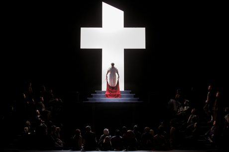 In the dramatic last moments of Dialogues of the Carmelites at Eastman Opera, Blanche makes her way to the guillotine bathed in the light of the cross. Photo by Nic Minetor