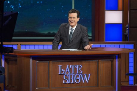 Stephen Colbert at his desk on the set.
