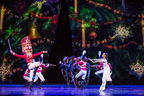 The Nutcracker (Alberto Velazquez) and Marie (Amanda Assucena) dance under the dramatically expanded tree during the battle with the rats. Photo by Cheryl Mann