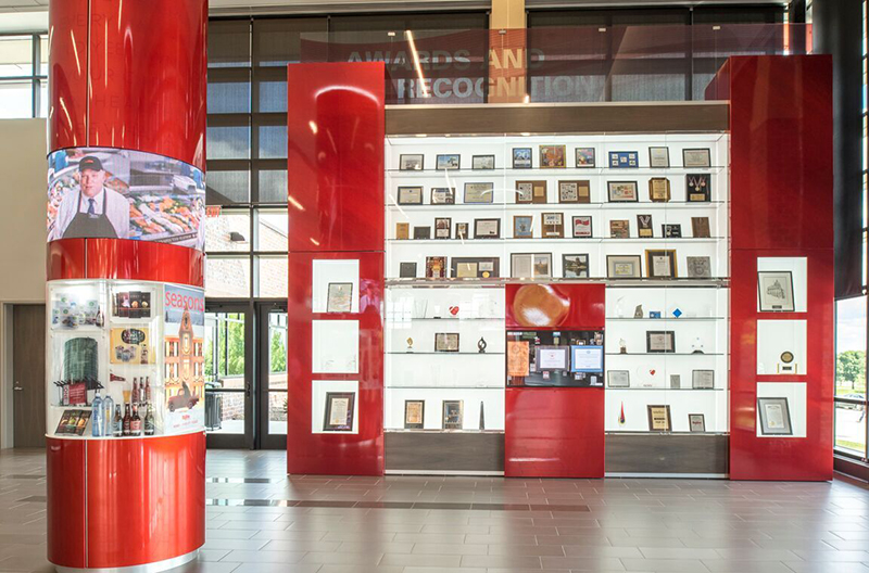 The Dwight Vredenburg History Pavilion within the lobby of Hy-Vee's new Ron Pearson Center makes use of NanoLumens' 360-degree Nixel Series LED displays.