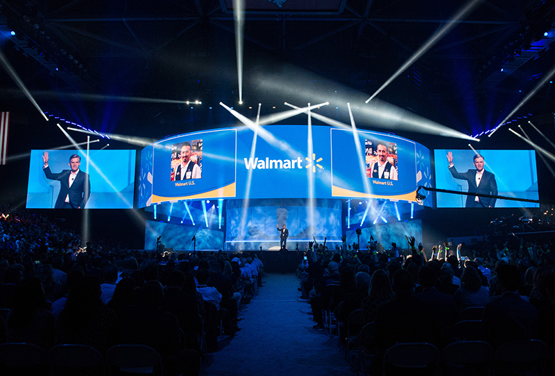 The curved LED display moved up and down to reveal company VIPs and musical acts. Photos courtesy Leo Events