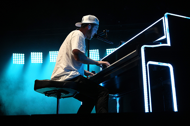 The LED laden upright piano in use. 2017 OneRepublic tour photo by Todd Kaplan.