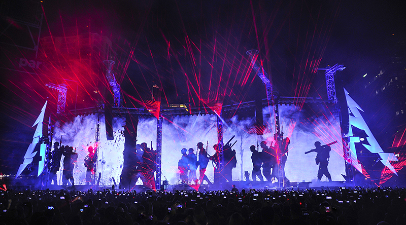 The War scene depicted in video and lasers. Metallica 2017 tour photo by Steve Jennings