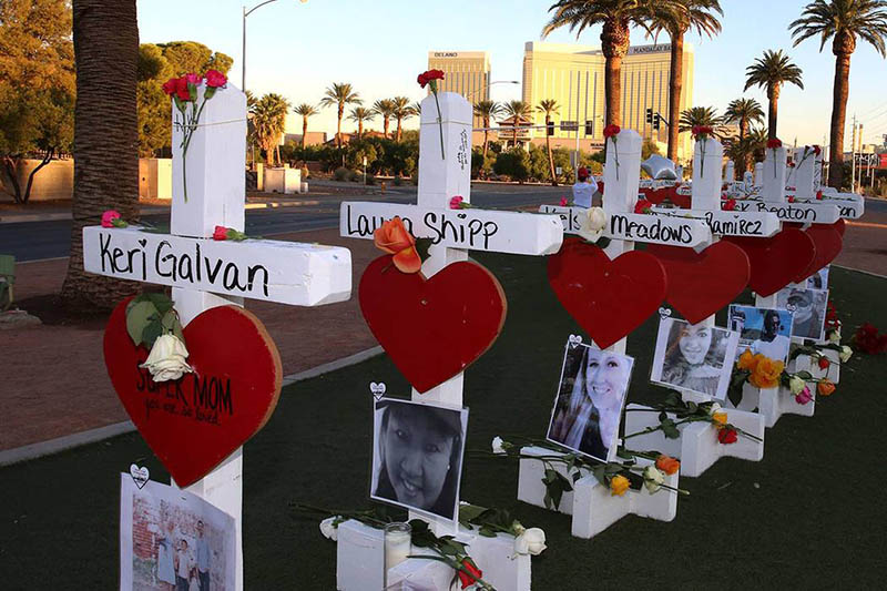 "The 58 ""Crosses for Losses"" near the Welcome to Las Vegas sign commemorate victims of the Route 91 Harvest Festival shooting Oct. 1. The crosses will be moved to the Clark County Museum in Las Vegas on Nov. 12."