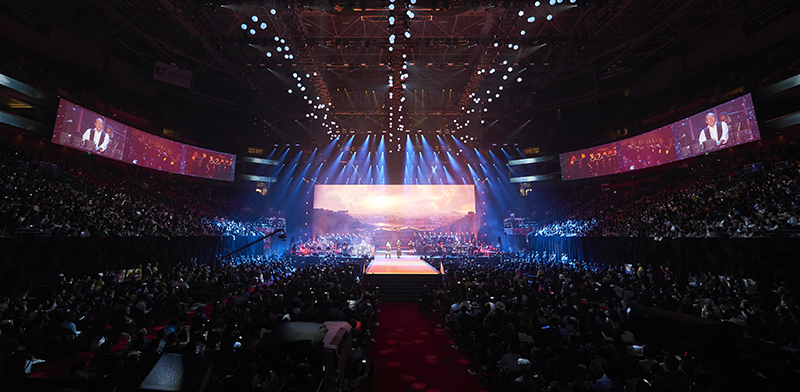 The center video wall and the side curved projection screens anchored the production