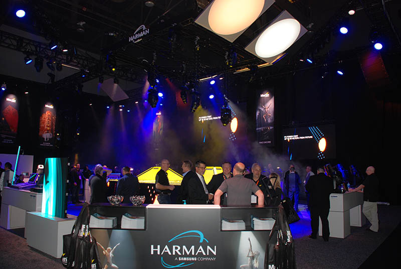 Harman's LDI booth shows the output of the two models on the screens above. Photo by Mike Wharton